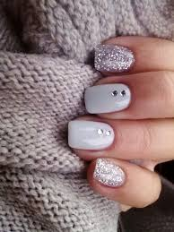 picture of white nails with rhinestones and glitter silver nails