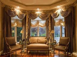 bay window drapes ideas with two table lamps on round glass side