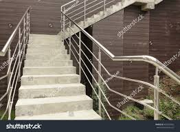 Stainless Steel Handrails For Stairs Outdoor Concrete Staircase Stainless Steel Handrail Stock Photo