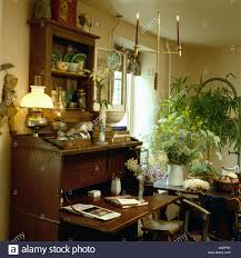victorian style lamp on antique desk in study dining room with