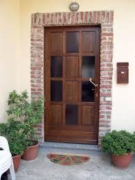 porte ingresso in legno artekna falegnameria costruzioni in legno su commessa moggio