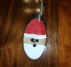 crafted wooden oval ornament santa clause 1