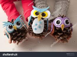 children holding felt pine cone owl stock photo 357864722