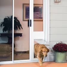 through the glass dog doors the cats access the catio through the sliding glass doors which have