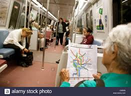 Metro Map Washington by An Elderly Lady Reading A Map Of The Metro Subway Rail System