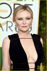 kirsten dunst flaunts major cleavage at golden globes 2016 with
