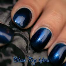 blue by you dark blue nail polish with highlights like the