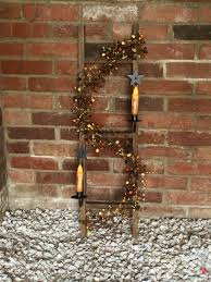 Country Star Home Decor Decorated Country Ladder With Berry Garland And Wrought Iron