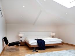 modern attic bedroom design displaying white wall colors scheme