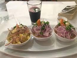 cuisine a la pescado a la picture of machu picchu peruvian cuisine