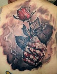 rose in bloody hand tattoo ideas tattoo designs