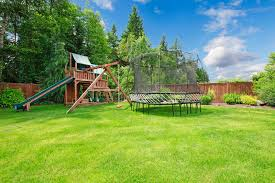 summer fenced backyard with play area stock photo image 27278078