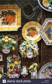 porcelain plates and ornamental objects outside a shop in the