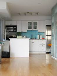 white kitchen cabinets and dark hard wood floors beautiful home design
