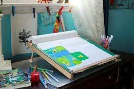 a slanted kids drawing table ergonomic and portable artful parent