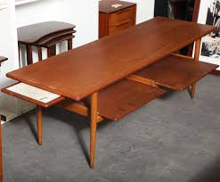 pull out coffee table 1950 s teak and oak coffee table with pull out trays at 1stdibs