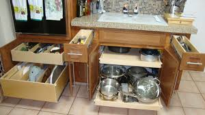 Interior Fittings For Kitchen Cupboards L Shaped Brown Stained Wooden Kitchen Cabinet With Three Tier Pull