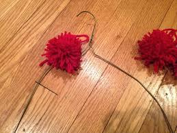 s day wreaths two it yourself diy pom pom yarn wreath on a wire hanger