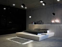 bedroom white matresses black hanging lamp cement wall design