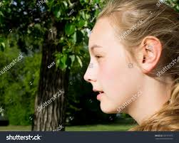 side view of pulled back hair in a bun side view face teenage girl long stock photo 287791973 shutterstock