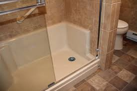 the homeowners old bath tub and replaced it with a walk in shower