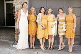 yellow bridesmaid dress 20 mismatched bridesmaid dresses for your modern wedding brit co