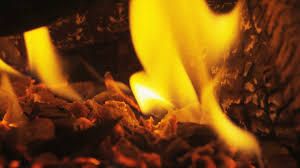 wood burning in fireplace close up of fire in slow motion logs