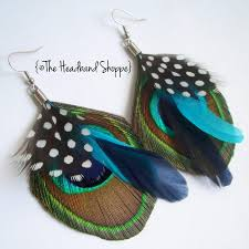 peacock feather earrings peacock earrings with guinea turquoise and navy accents atlantis