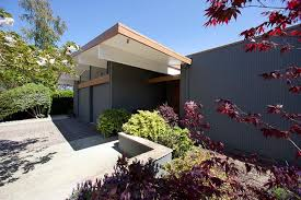 Modern Two Storey House With Streamline Roof by Roots Of Style Midcentury Modern Design
