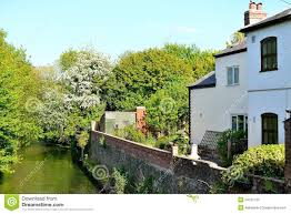 old english cottage on the river stock photo image makeovers what