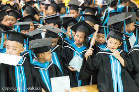 kids cap and gown graduation day at mercy center globalgazglobalgaz