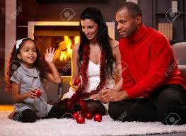At Home Christmas Decorations by Beautiful Diverse Family At Home In Christmas Time Sorting