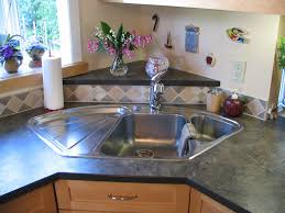 blanco corner sink with raised back triangle laminate in blanco