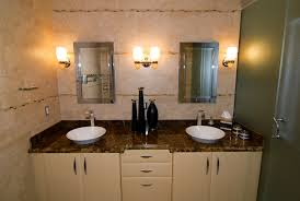white wooden double bathroom vanities with brown granite top and