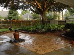 fence ideas for small backyard small backyard landscaping design using stone flooring and green