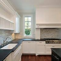 white hanging cabinet finish patterned black granite countertop