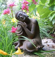 garden with flower plants and buddha statue buddha garden
