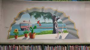 new mural created to inspire childrens imagination at green cove new mural created to inspire childrens imagination at green cove springs library jacksonville news sports and entertainment jacksonville com