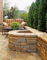 Backyards Ideas Patios by Half Circle Stacked Stone Firepit With Attached Seating Wall