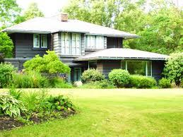 frank lloyd wright inspired home with lush landscaping frank lloyd wright style home idea features dark grey home design
