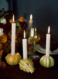 diy gourd candle holder with taper candles for thanksgiving
