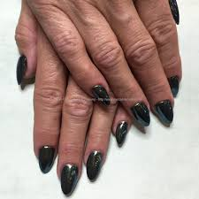 social build acrylic nails with black gel polish and green