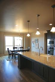 7 best kitchen light box images on pinterest open dining and kitchen area oversized island with granite countertops real hardwood floors