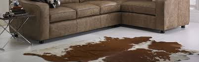 Patchwork Cowhide Interior Faux Cowhide Rug With Brown Upholstered Sectional Sofa