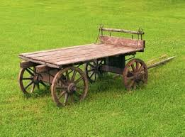 image 8028472 fashioned wooden cart in a green grass field