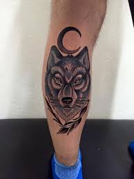 moon and wolf on back leg