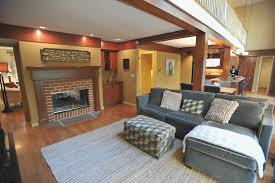 best family room color with wood trim and gray sofa also carpet