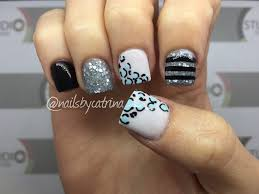 super short square acrylic nails with cheeta and striped accent