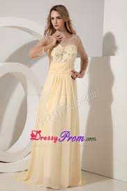 beaded light yellow prom dress with sheer long sleeves