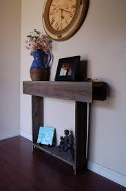 great small entryway table furnished by sculpture and photo frame